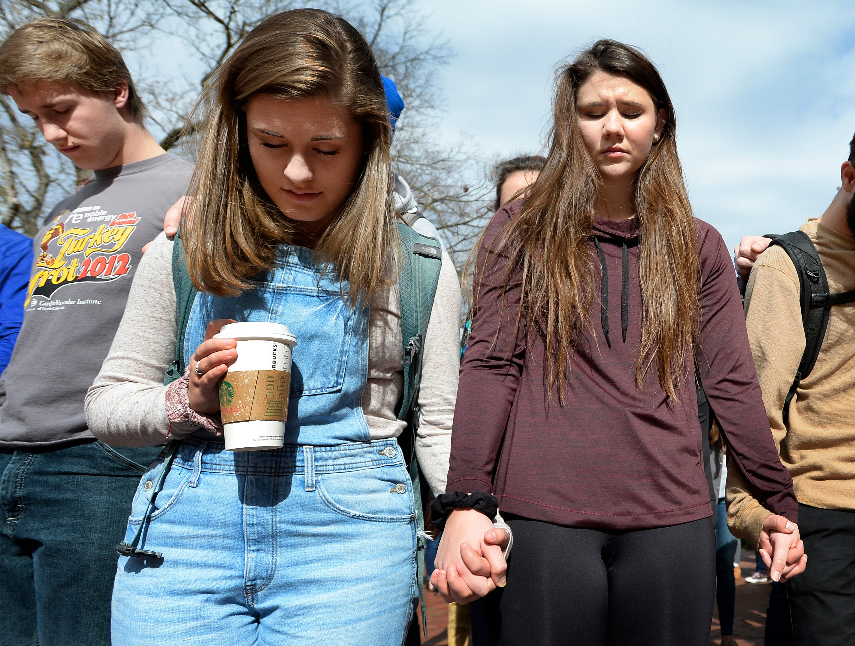 Students spend a moment in silence during a  prayer service at Lipscomb University on Thursday, Nov. 8, 2018, in Nashville, Tenn. The event honored the 12 victims of a mass shooting at a bar Wednesday night in Southern California. College students from Pepperdine University were in the bar at the time of the shooting. Both Pepperdine and Lipscomb are affiliated with the Churches is Christ.