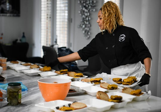 Chef Charity Morgan, wife of Titans linebacker Derrick Morgan prepares vegan meals for about a dozen of her husband's teammates  Friday, Nov. 2, 2018, in Nashville, Tenn.