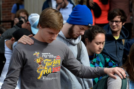 Students spend a moment in silence during a prayer service at Lipscomb University on Thursday.
