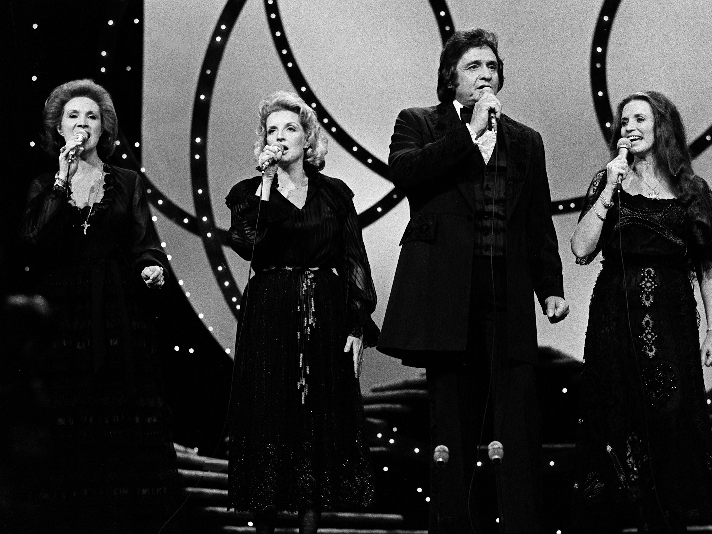 Host Johnny Cash performs with Jan Howard, left, Helen Carter and wife June Carter Cash during the 12th annual CMA Awards show at the Grand Ole Opry House on Oct. 9, 1978.