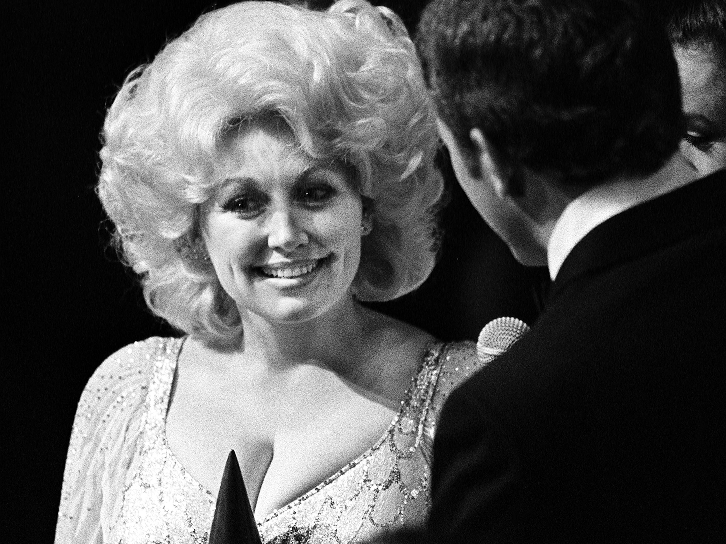 Entertainer of the Year winner Dolly Parton, left, is interviewed backstage at the 12th annual CMA Awards show at the Grand Ole Opry House on Oct. 9, 1978.