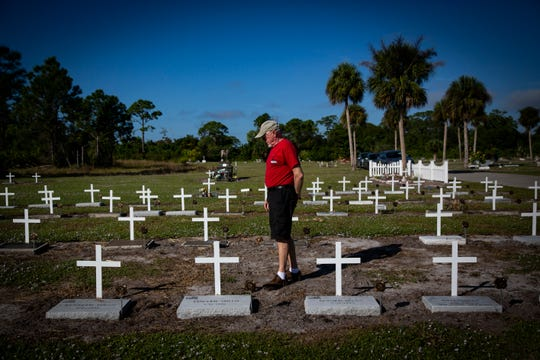 """Terry Wyatt, an Air Force veteran from Naples, walks through the restored veterans cemetery at Lake Trafford Memorial Gardens in Immokalee before a dedication ceremony hosted by the Golden Gate Veterans of Foreign Wars Post 7721 on Thursday, Nov. 8, 2018. """"I wish we honored the vets more,"""" Wyatt said. Over the past few years, the Golden Gate VFW has worked to restore 94 graves of war veterans and provide crosses, flags, VFW medallions and a white picket fence."""