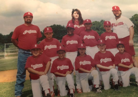 Casey Cheney Sr., top row, far right, coached Immokalee youth sports teams for years. Here, he is shown coaching a Little League baseball team. Current Immokalee High School defensive backs coach Louis Gachette, second row, second from right, was on the team. Cheney was Gachette's godfather.