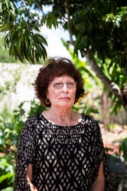 Michele Ozkan stands at the Fruitville Public Library in Sarasota, Fla., on Monday, June 25, 2018. Ozkan's mother, Stella Budich, died while in the care of Tarpon Point Nursing and Rehabilitation Center in August 2014.