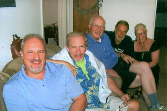 Malcolm Luckin, second from left, in an undated family photo.