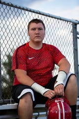 Immokalee High Schoollineman Casey Cheney, 17, sits by the field after football practice on Wednesday, Nov. 7, 2018. On Sept. 10, 2018, Casey was meant to go out on a trip with his father, Casey Cheney Sr., to Palm Bay to buy saw palmetto berries, an activity they often did together. Football practice kept him from going. Later that day he found out his father had been found shot to death.