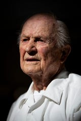Earl Page, who served as a petty officer first class in the Navy during World War II, poses for a portrait on Wednesday, Nov. 7, 2018, at The Carlisle in Naples.