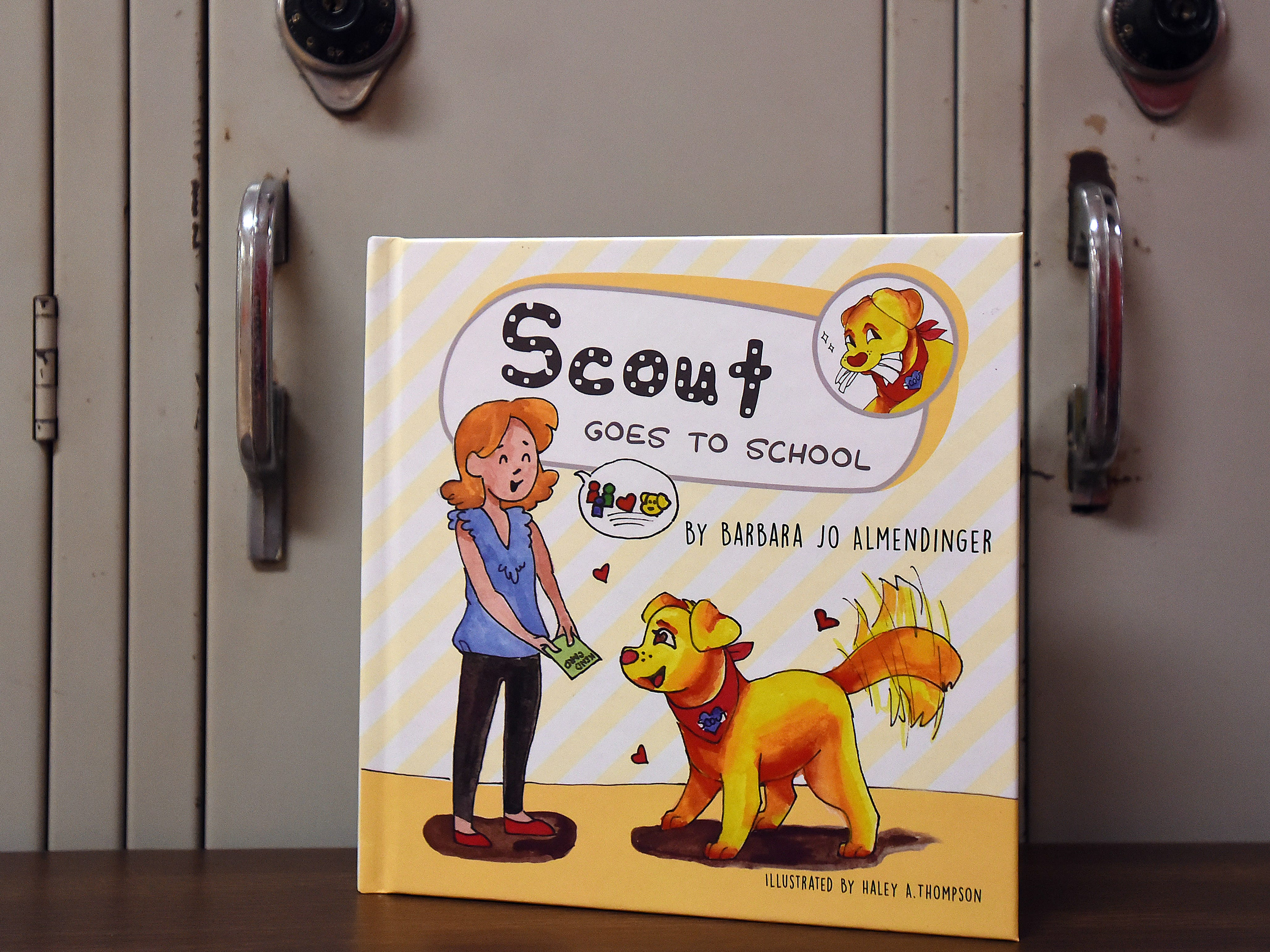 """Utica Middle School language arts teacher Barb Almendinger wrote a children's book """"Scout Goes to School"""" about the therapy dog, Scout."""