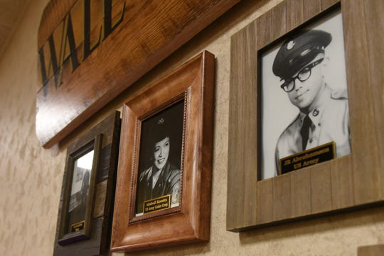 A portrait of Idabell Koontz hangs on the wall along with other residents who served in the armed forces at The Inn at Chapel Grove in Heath.