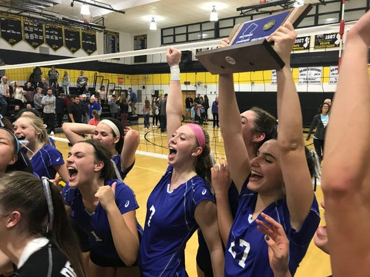 NV/Demarest players Niki Woods (1), Sedona Gaard (7) and Alicia Iafrate (27) celebrate the Norsewomen's 2-1 win over River Dell in Wednesday's NJSIAA Group 3 girls volleyball semifinal. NV/Demarest earned a sectional championship trophy and advanced to Saturday's final.