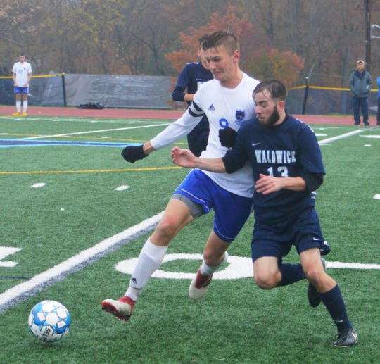 Wallington junior Damian Zurawski (left) battling Waldwick's Thomas Jahnke.