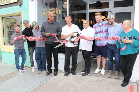 The ribbon is cut at Grindage Wood Fired Pizza & Sandwiches in Montclair.