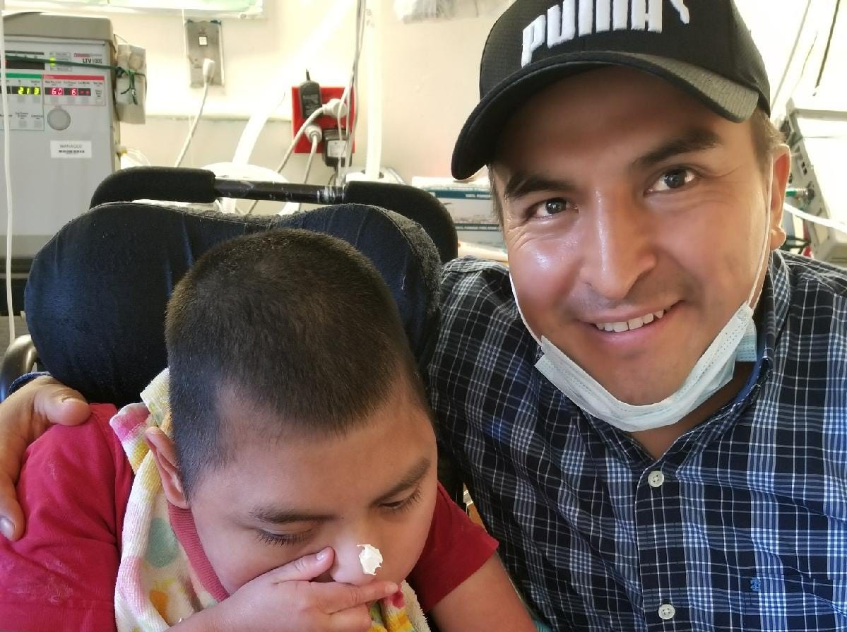 Angel Ojeda with his son, Angel, 9, at the Wanaque Nursing and Rehabilitation Center. Angel was among the children who reside at the center who contracted the adenovirus, his father said. He's recuperating at the center.