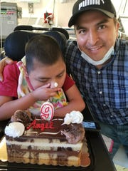 Angel Ojeda with his son, Angel, 9, at the Wanaque Center for Nursing and Rehabilitation.  Angel Jr.,  was among the children who contracted adenovirus in an outbreak at the center, his father said. He has been taken to a hospital with a high fever.