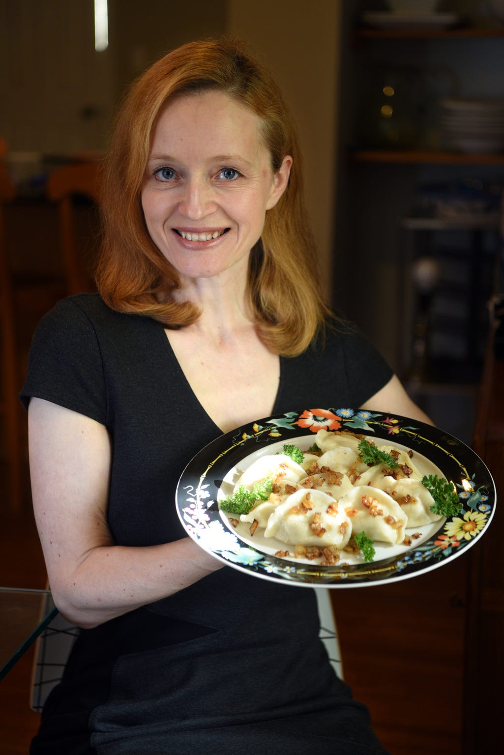 Renata Martin makes pierogies with turkey stuffing served with sauteed onions.