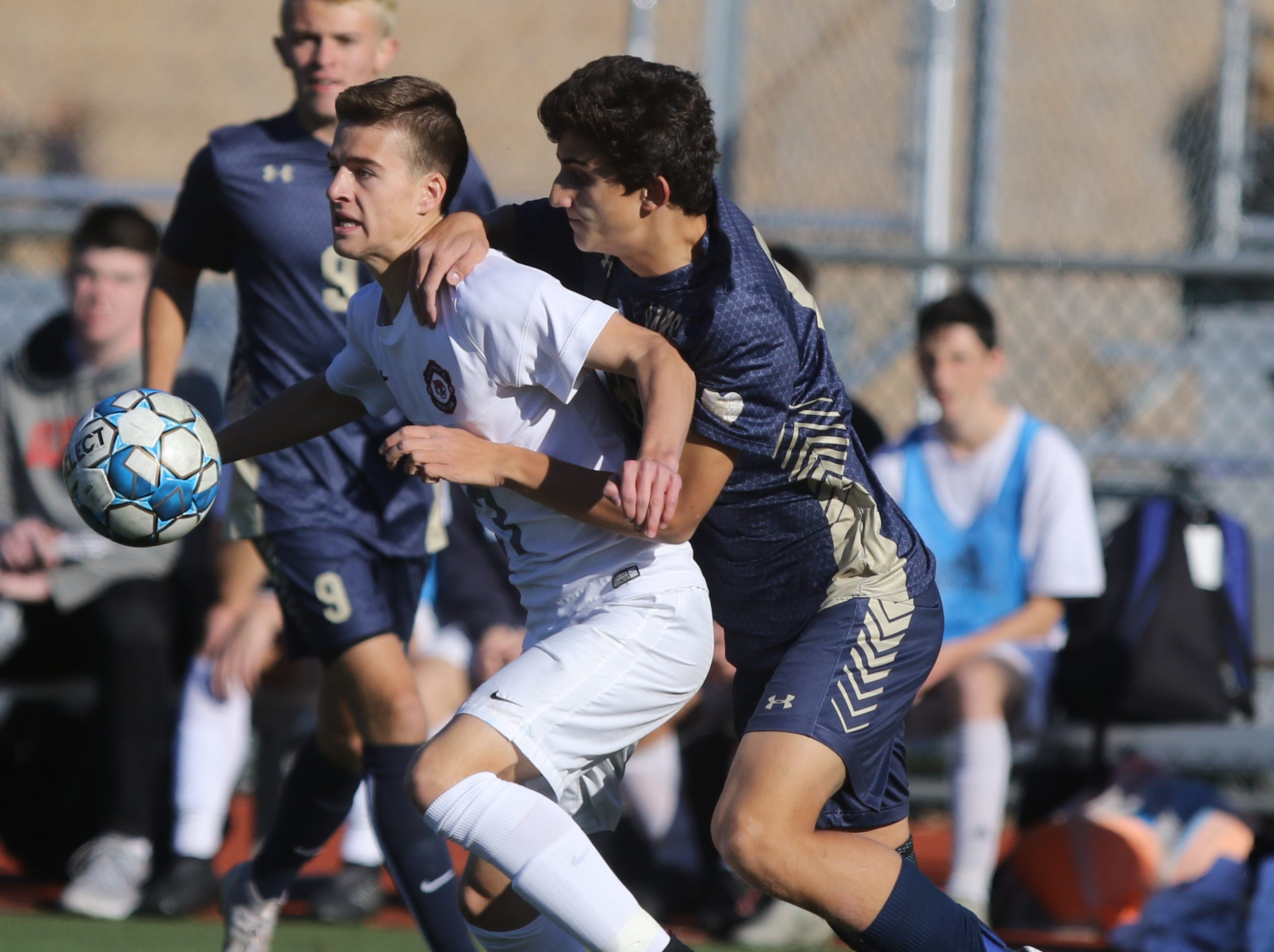 Conor Daly of Glen Rock takes the ball in front of Lucas Souza of Ramsey in the first half.