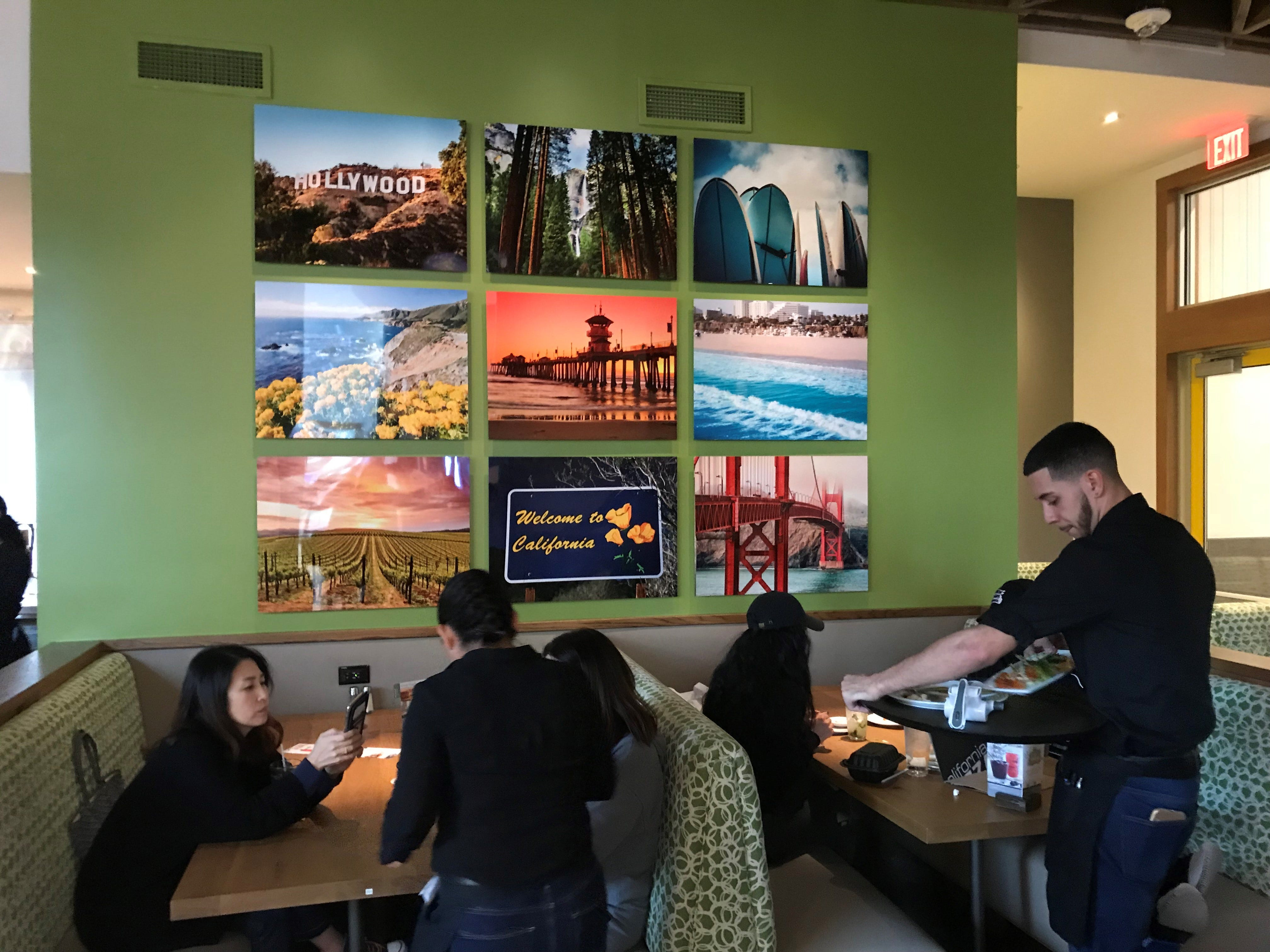 "The new California Pizza Kitchen design tries to create a ""California vibe."""