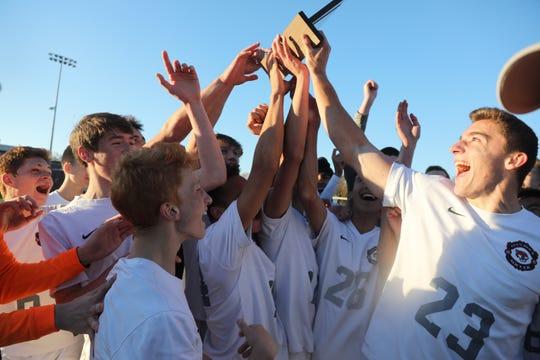Glen Rock celebrates winning their North 1, Group 2 win.