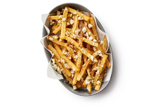 The Greek fries come topped with feta, oregano, garlic salt, red wine vinegar.