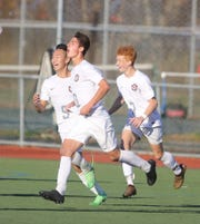 Josh Kim celebrates Glen Rock's second goal scored by Nick Rogers. With them is Ben Zakowski who scored three goals for Glen Rock.
