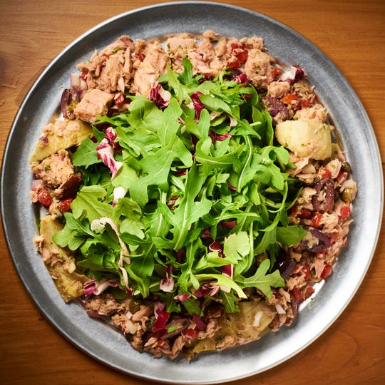 The tuna salad at Grindage Wood Fired Pizza & Sandwiches is mayo free, and instead doused in olive oil and vinegar.