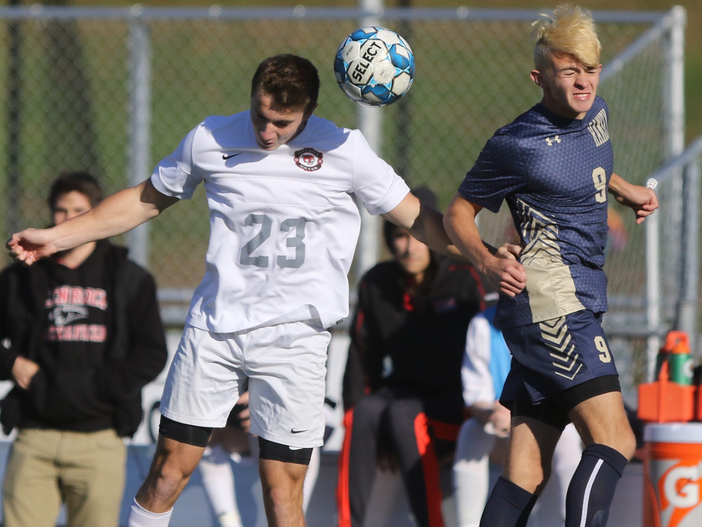 Mark Buckel of Glen Rock heads the ball in front of Alex Schneider of Ramsey in the first half.