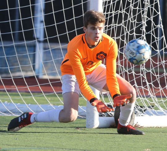 Glen Rock goalie Noah Beverin makes this save in the second half.