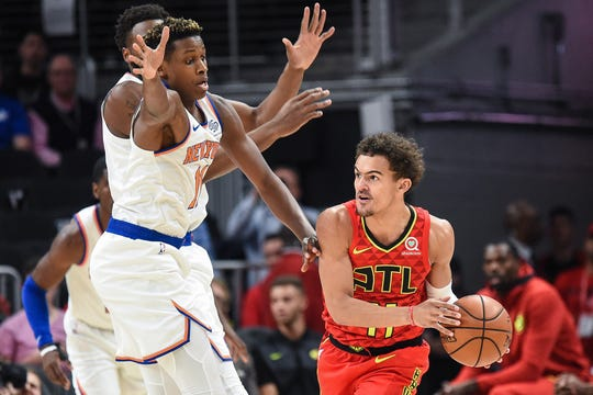 Atlanta Hawks guard Trae Young (11) looks to pass the ball as New York Knicks guard Frank Ntilikina (11) defends during the first half at State Farm Arena.