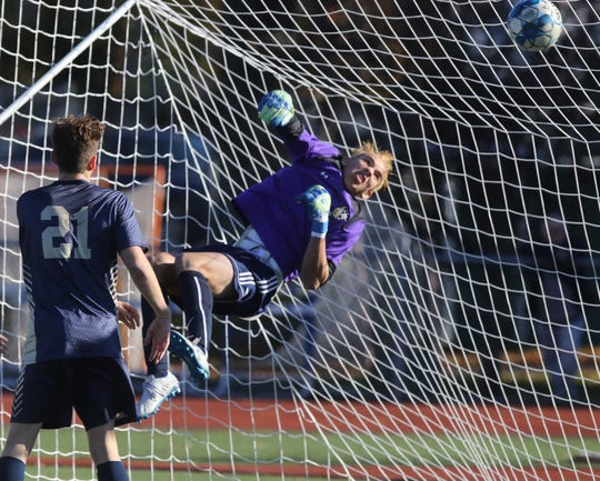 Ramsey goalie Justin Siegel keeps this ball out of the goal in the first half.