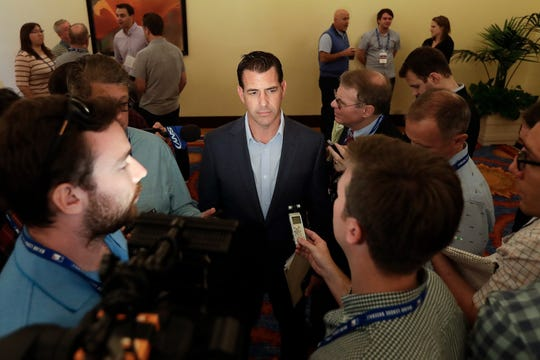 New York Mets general manager Brodie Van Wagenen, center, speaks to reporters during the baseball general managers meetings Wednesday, Nov. 7, 2018, in Carlsbad, Calif.