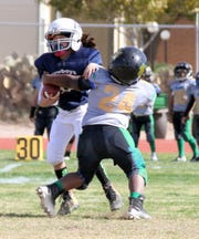 The Southwestern New Mexico Football League held its Super Bowl Sunday on Nov. 4 at the Deming High Memorial Stadium. The Deming Cowboys completed an undefeated season with a 33-0 championship win over the Deming Outlaws. Here are some action photos from the Super Bowl contest.