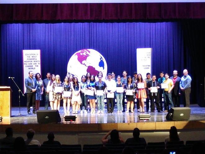 The awarding of Bilingualism-Biliteracy Seals to Deming High School students last year.