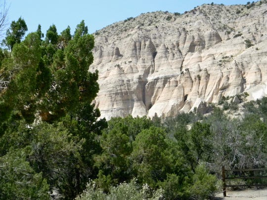 Erosion-formed hoodoos are evident from the parking lot at Kasha-Katuwe Tent Rocks National Monument in northern New Mexico.