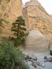 Swirling  wind and water make the hard rock look like folds of silken cloth at Kasha-Katuwe Tent Rocks National Monument in northern New Mexico.