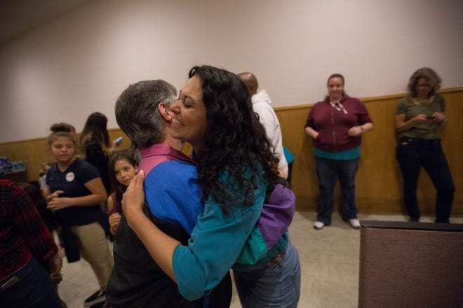 Xochitl Torres Small, right, hugs Connie Chapman during a celebration at the Torres Small campaign office Wednesday, Nov. 7, 2018, after she received word that she had pulled ahead in the race for U.S. Congressional District 2.