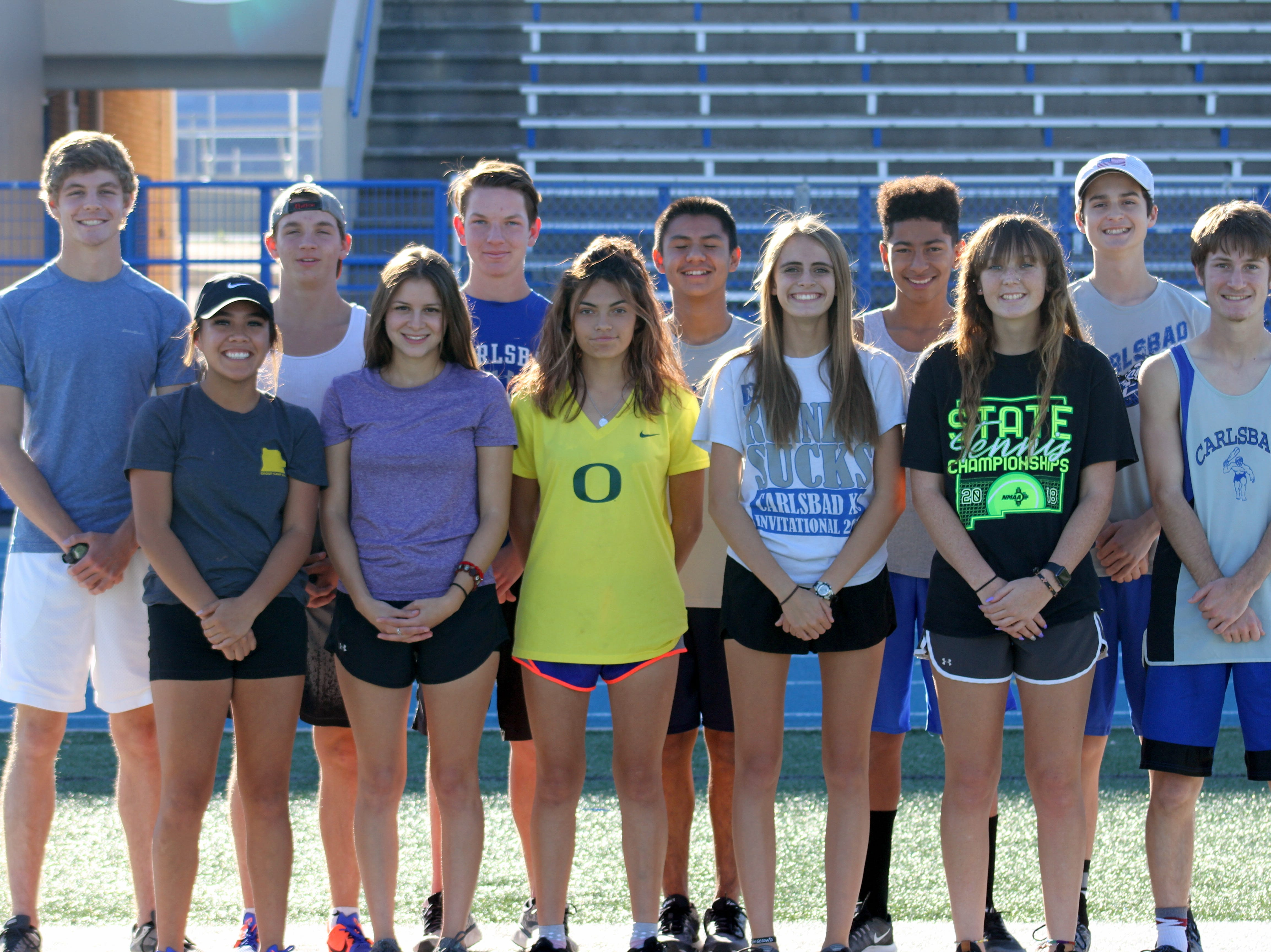 Members of the 2018 Carlsbad Caveman cross country team pose before Wednesday's practice. For the first time in three years Carlsbad will be sending both its boys and girls cross country teams to compete in the state meet.