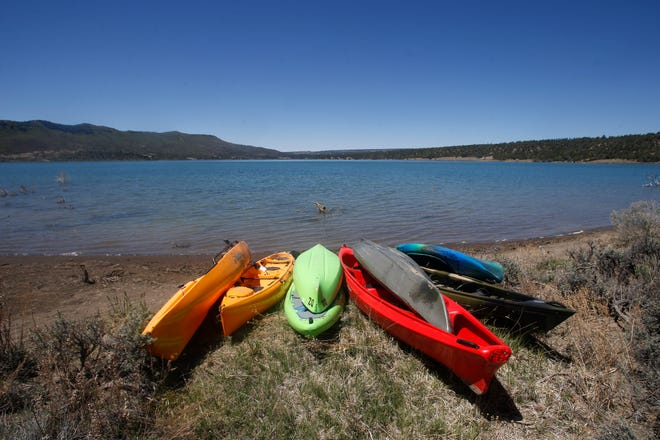 Kayaks sit on the shore May 14 at Lake Nighthorse in Durango, Colo.