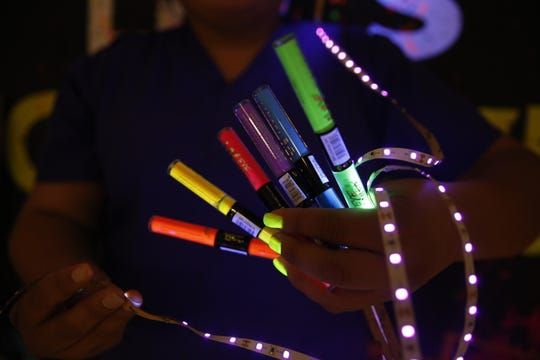 Cosmetology students will apply products such as glow in the dark liquid eye shadow to attendees at the Glow Dance Party.