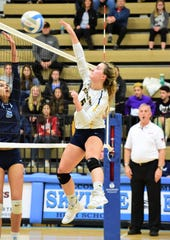 South Lyon's Emily Kalinowski (right) goes over Skyline's Kendall Murray for the kill.