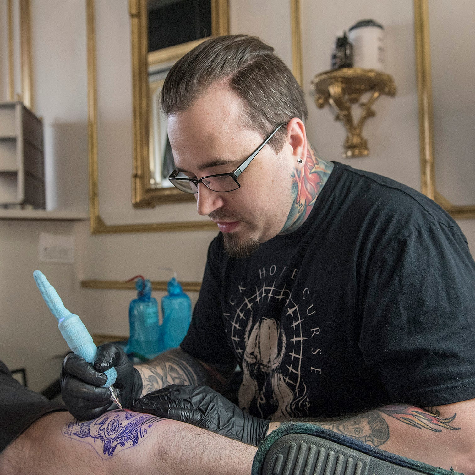 Tattoos, oil paintings and ... a phantom? Livonia artist brings his talents to new studio