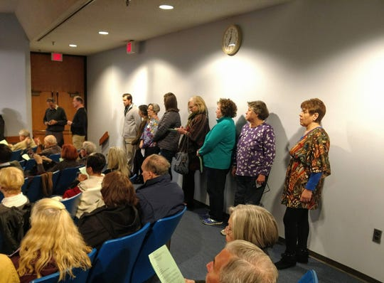 Residents line up to speak at the Livonia City Council meeting over a building seemingly purchased by Planned Parenthood on Farmington Road.