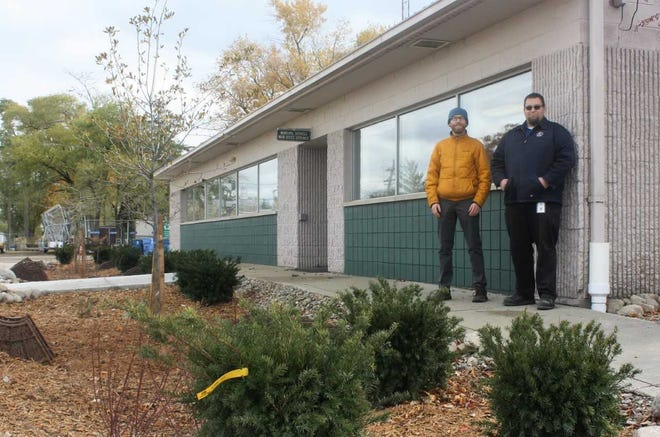 Matthew Bertrand and Adam Gerlach teamed up to kick-start a flood-eliminating project in front of the Plymouth Municipal Services headquarters.