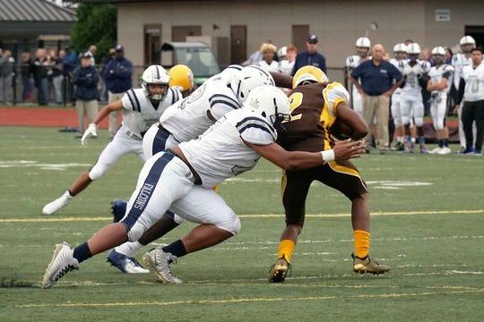 Farmimgton senior captain Donovan King makes a tackle.