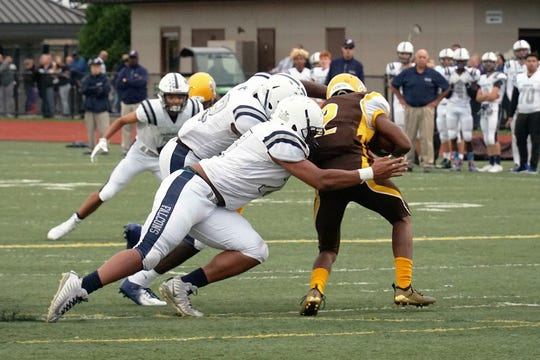 Farmimgton senior captain Donovan King makes a tackle.