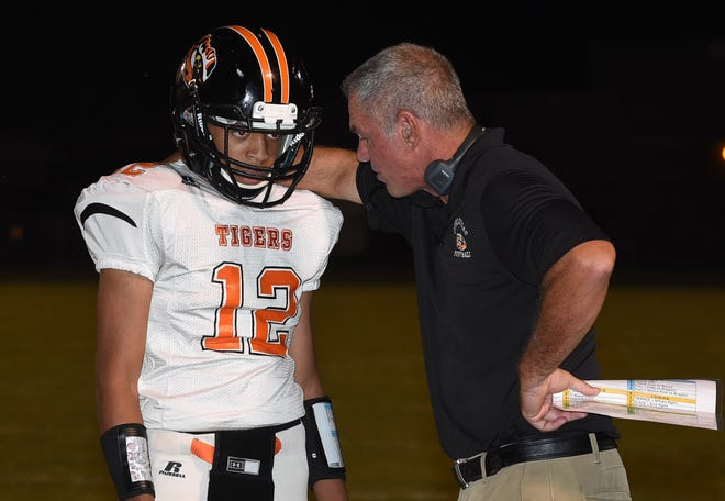 Opelousas High head football coach Doug Guillory talks with quarterback John Guilbeaux during a game earlier this season. The Tigers play at Neville on Friday night in a Class 4A contest.