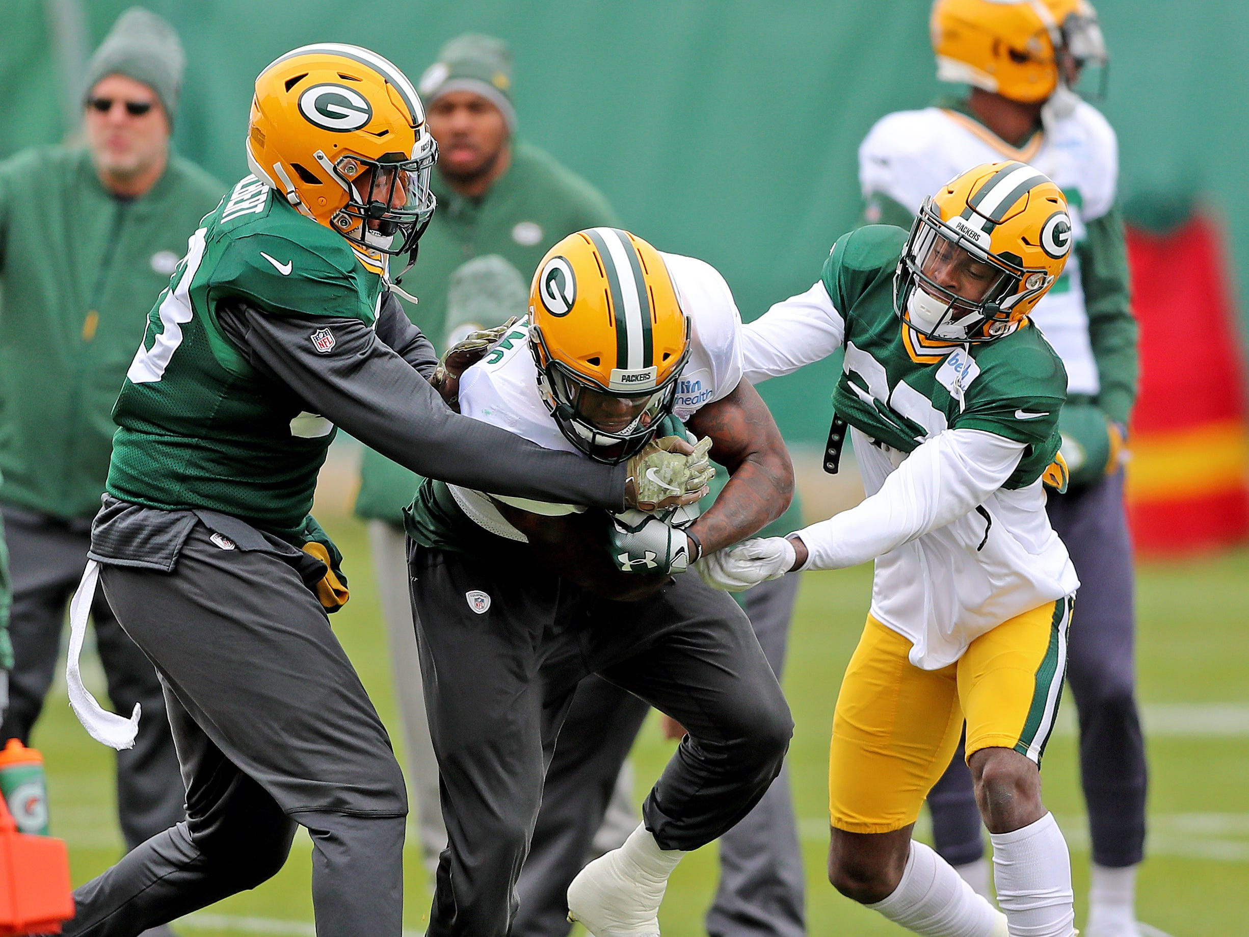 Green Bay Packers running back Jamaal Williams (30) battles linebacker Reggie Gilbert (93) and cornerback Josh Jackson (37) during practice Thursday, November 8, 2018 at the Don Hutson Center in Ashwaubenon, Wis.