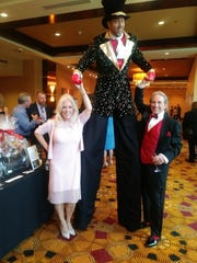 Honoree Joel Johnson and wife Christy share a laugh with Too Tall Tomm