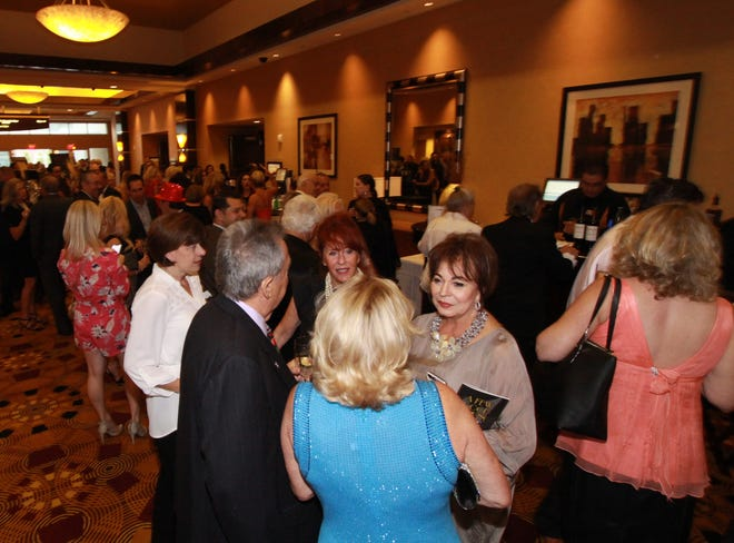 Guests deciding on which fabulous silent auction items to bid on.