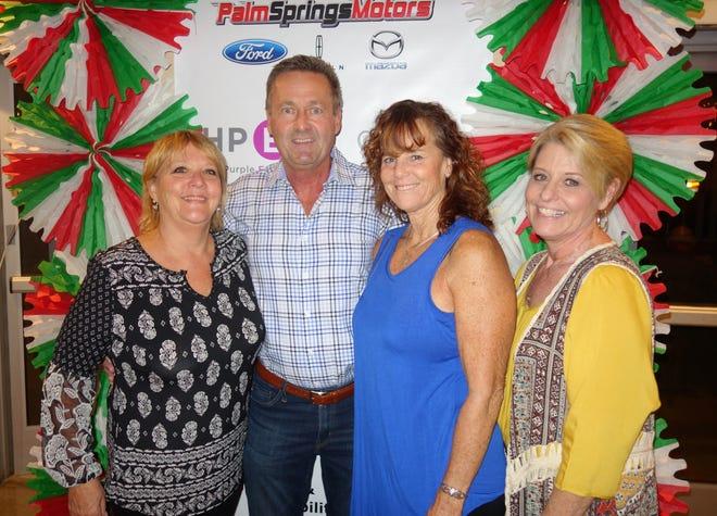 Chris O'Hanlon, founder, poses with members of the Senior Advocates of the Desert team, including Trudy Tedder, Dena Bates and Nena McCullough.