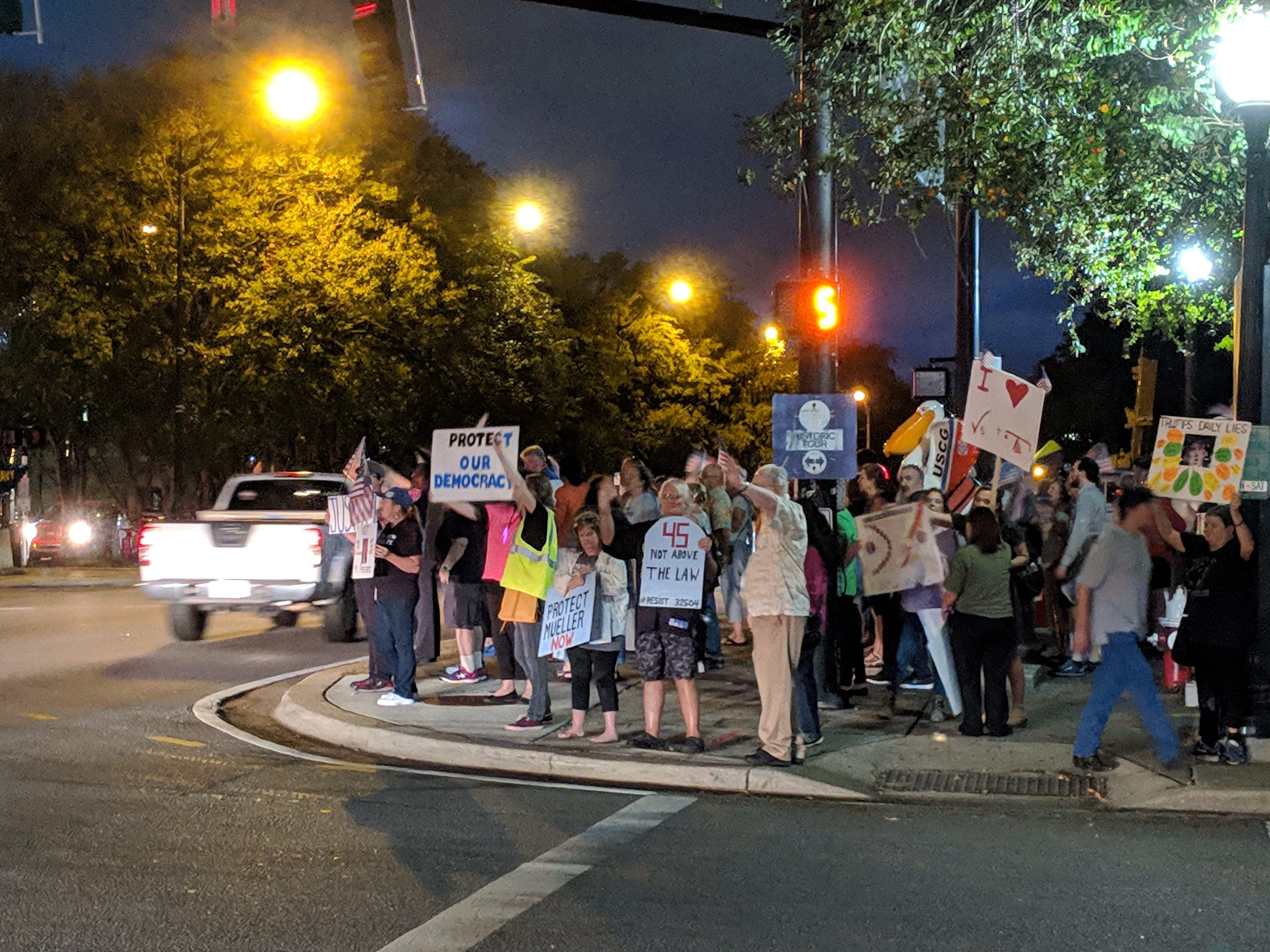 Just over 40 protestors hold a demonstration at the intersection of Garden and Palafox Street in support of the investigation into Russian interference in the 2016 presidential election.